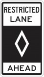 restricted lane ahead sign